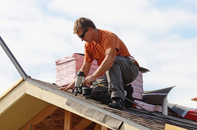 roofing contractor on roof doing a repair