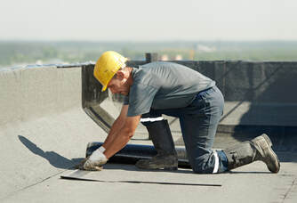 commercial roofer on commercial building